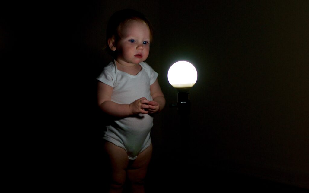 photo of baby and lamp